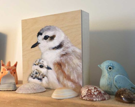 Print of snowy plover and chick mounted on wood by Maggie Hurley