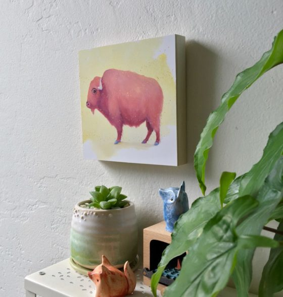 pink bison art by maggie hurley mounted on wood. profile view
